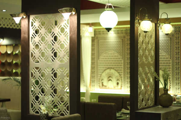 Restaurant design shaam e avadh baroda pomegranate design for Pomegranate interior design decoration