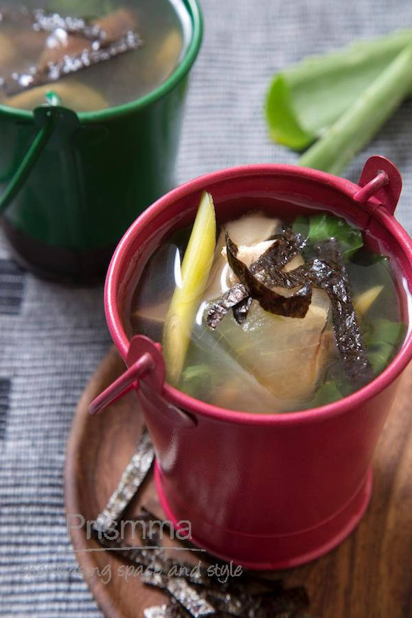 Asian clear soup with spinach and seaweed