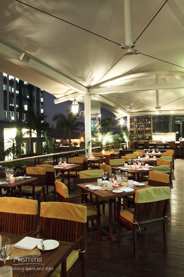 Bangalore restaurant fava all day dining interior design for Terrace restaurants in bangalore