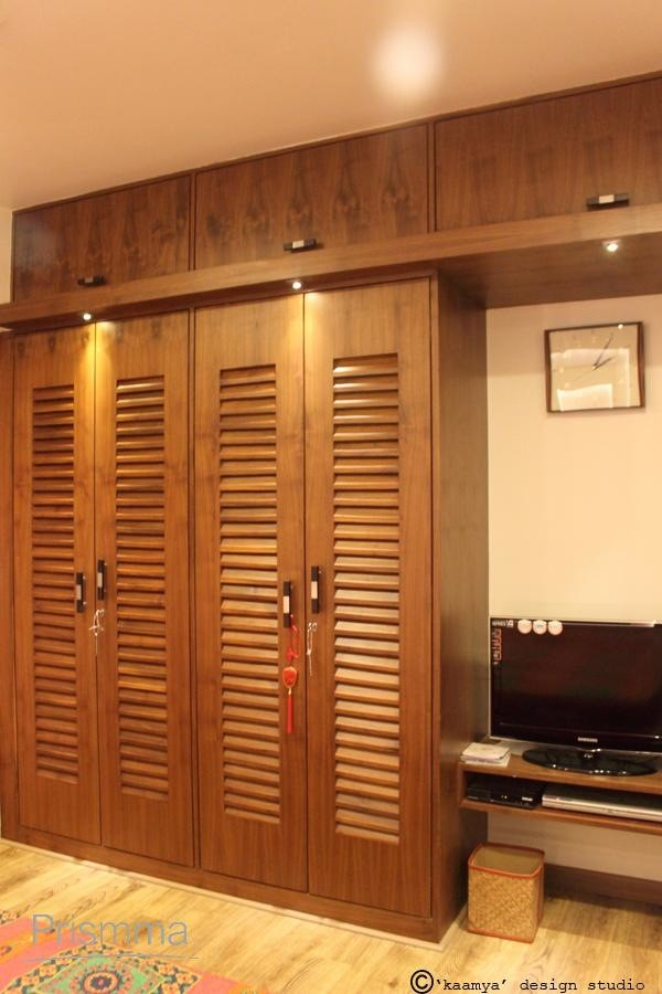 Wardrobe design wood finishes interior design travel for Bedroom wooden wardrobe designs india